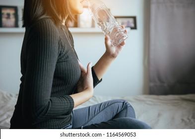 Asian woamn having or symptomatic reflux acids,Gastroesophageal reflux disease