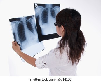 asian woman is analysing the x-ray images