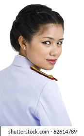 asian woman in army uniform looking back over her shoulder, isolated on white background