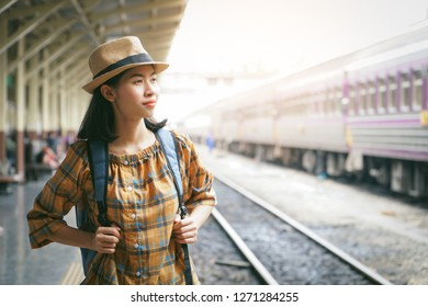 DEANNA: Asian girl comes on train