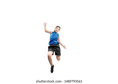 Asian woman basketball player in action isolated over white background