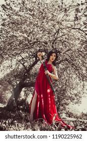 Asian woman in beautiful red dress
