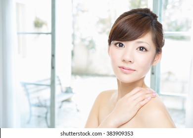 Asian woman with beauty face and perfect skin