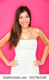Asian woman beauty smiling portrait on pink background. Beautiful multiracial Caucasian Chinese model with long brown hair. Brunette girl with perfect smile.
