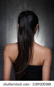 Asian Woman before applying make up hair style. no retouch, fresh face eyes with acne, wart, nice and smooth skin, rear side back view. Studio lighting abstract blur dark gray background,