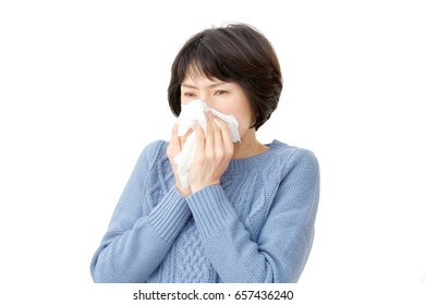 Asian woman blow her nose
