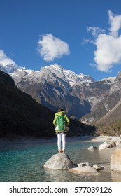 Asian woman at Blue moon valley in lijiang city ,China.It  at the foot of Jade Dragon Snow Mountain.
