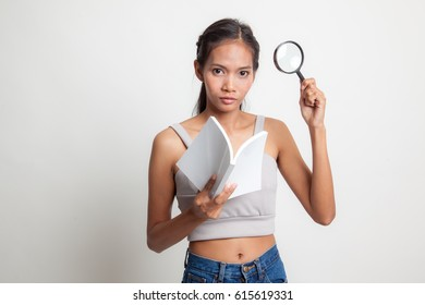 Asian woman with a book and magnifying glass on white background