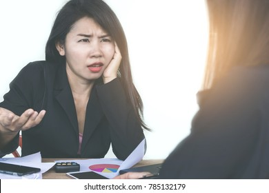 Asian woman boss angry and complaining her teamwork during working together in a meeting room