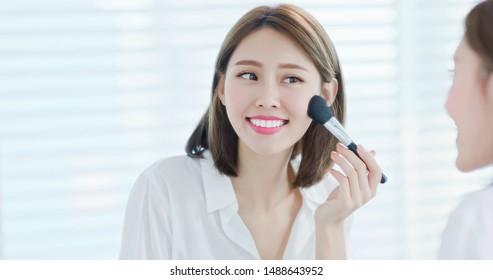 asian woman brush blush in the morning