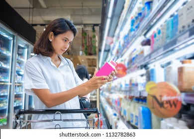 asian woman buying in the supermarket