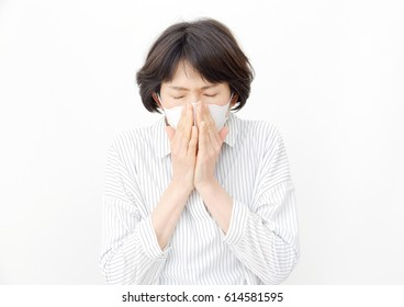 Asian woman catching a cold