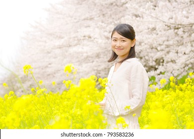 Asian woman and cherry blossoms