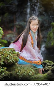Asian woman with Chinese traditional dress ,Chinese new year concept.
