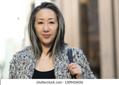 Asian woman in city face portrait