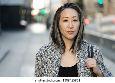 Asian woman in city serious face portrait