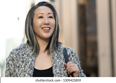 Asian woman in city smile happy portrait face
