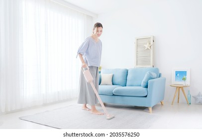 Asian woman cleaning at home