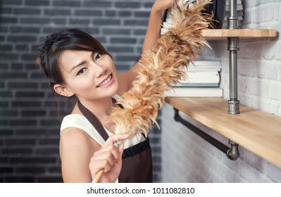 Asian woman cleaning house happy mood,focus on face