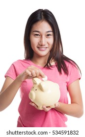 Asian woman with coin and pig coin bank  isolated on white background.