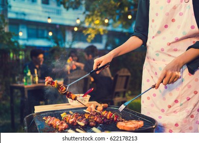 Asian woman are cooking for a group of friends to eat barbecue