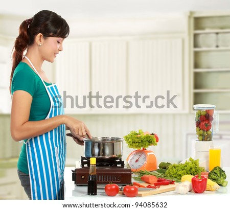 asian woman cooking in the kitchen - Cooking In The Kitchen