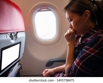 Asian woman cough symptom of throat in the airplane