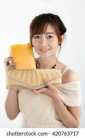 Asian woman customer shopping fashion handbag and purse