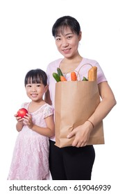 Asian Woman and daughter carrying groceries in isolated White Background