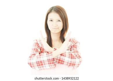 Asian woman demonstrating prohibiting gesture.