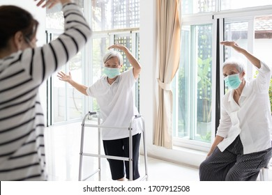 Asian woman is doing exercise activities for the elderly people,family workout to reduce stress during the pandemic of Covid-19,fight the Coronavirus,healthy senior, fitness for health care,stay home