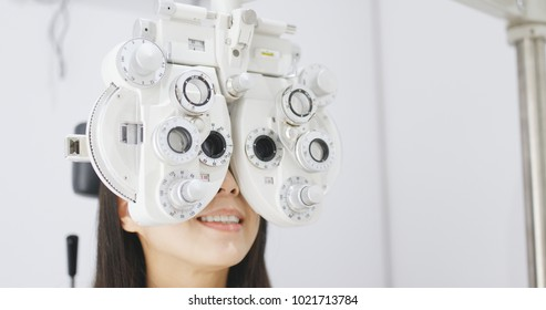 Asian Woman doing eye test in clinic