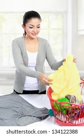 asian woman doing the laundry at home
