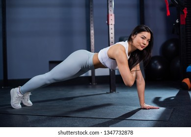 asian woman doing plank workout