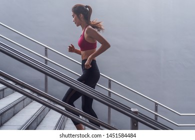 asian woman doing quick and small steps in city environment cross fit training