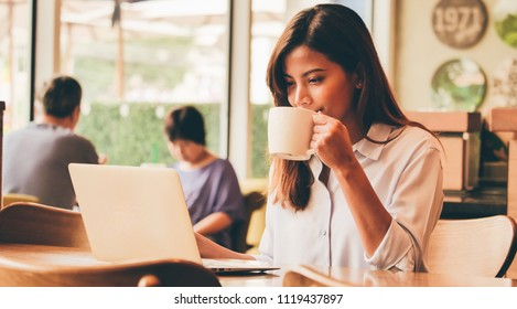 Asian Woman drinking coffee at morning breakfast during working at cafe' banner. Happy Asian girl working food blogger .