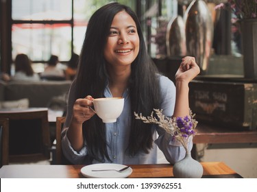 Asian woman drinking coffee vintage color tone