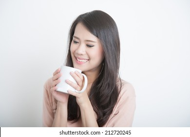 asian woman drinking and smell coffee