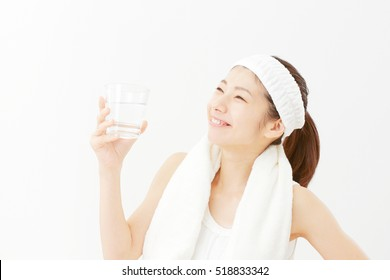 Asian woman drinking the water