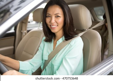 Asian woman driving