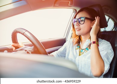 asian woman driving a car