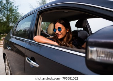 Asian woman driving on the car travel business concept