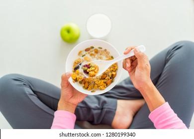 Asian woman Eating healthy breakfast bowl