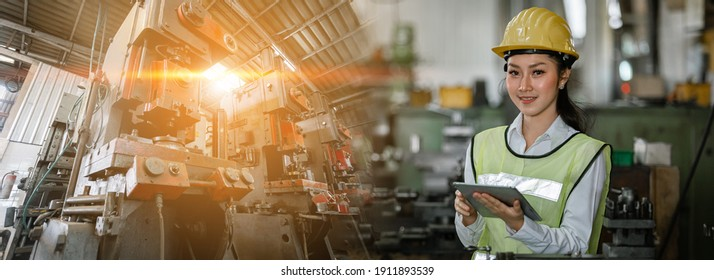Asian woman engineer industry heavy worker wearing hardhat and holding tablet, double exposure at machine area in factory, factory industrial concept.