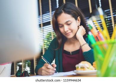 asian woman enjoy with her job