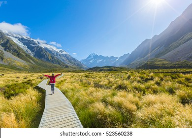 Asian woman enjoy travel at Mt cook national park in South Island New Zealand, Summer Time, concept of woman solo travel and relaxation moment
