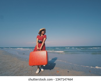 Asian woman enjoy with vacation travel on the beach blue sky background vintage color tone