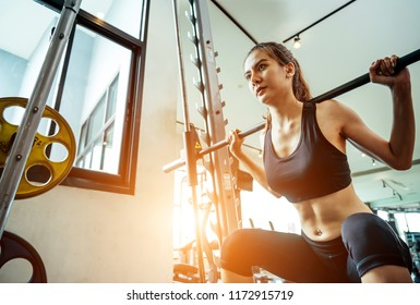 Asian woman exercising in the gym, Young woman workout in fitness for her healthy and office girl lifestyle.