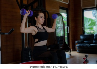 Asian woman exercising in the gym, Young woman workout in fitness for her healthy and office girl lifestyle