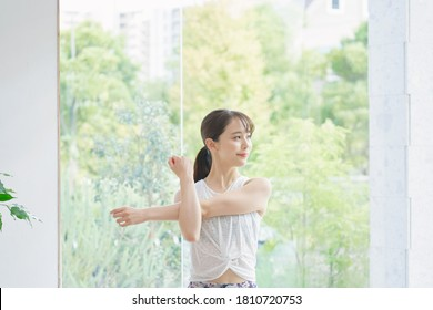 Asian woman exercising at home - Shutterstock ID 1810720753